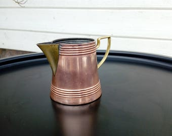 Small creamer made in coppar and brass