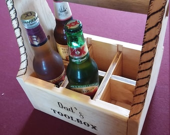 Handmade and wood burned 6-pack carrier.