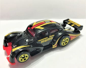 Fridge Magnet:Black Volkwagen Käfer Racer w/Yellow & Red Momo Performance Parts Graphics Hot Wheels®