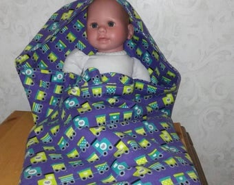 Hooded double layered bath towel for baby 100% absorbent flannel. Little chuga train in yellow and turquoise on purple background. 35x37.