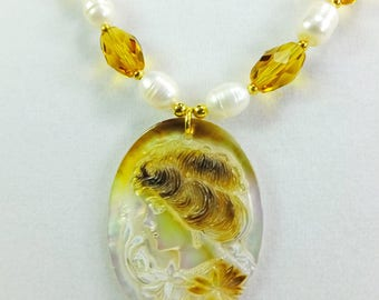 Cameo Carved into White Shell with Freshwater Pearls, Amber Glass Beads and Tiny Gold Plated Spacer Beads Necklace