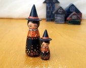Mother and daughter witches peg dolls