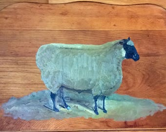 Black faced sheep on table top