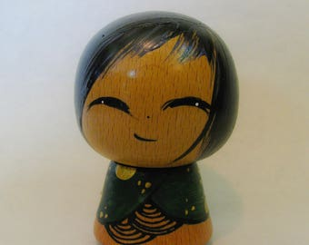 The little Kokeshi with the green kimono