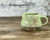 Porcelain mug. Celery green glazed mug. Floral pattern, dotted texture. Handmade pottery mug. Porcelain pottery mug. Green mug, flowers.