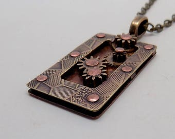 Steampunk mixed metal jewelry pendant. Steampunk jewelry pendant.