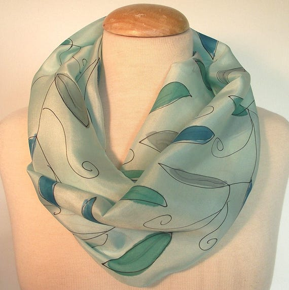 "Hand Painted Silk Infinity Scarf, 9x60"", Seafoam Background with Aqua, Teal and Grey Leaves and Black Line Drawing"