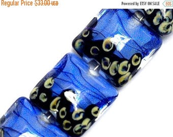 ON SALE 35% OFF Four Arctic Blue Shimmer Pillow Beads - 10413414 Glass Lampwork Bead Set