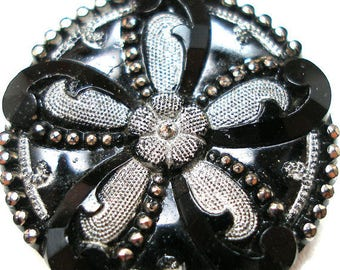 "1800s Victorian black lacy glass with silver luster flower, 7/8"". Imitation fabric design."