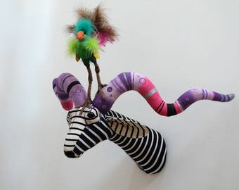 Large fantasy antelope fauxidermy sculpture. Upcycled monochrome textile art trophy with quirky bird.