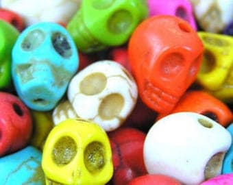 Skull Beads Day of the Dead 14 mm x 18 mm, about 25 beads per 16 inch strand OE0800B
