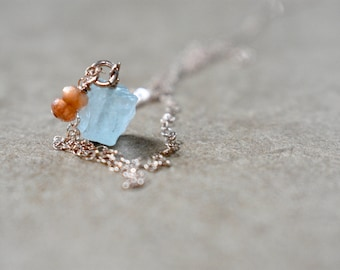 raw rough aquamarine pendant necklace with tiny sunstone stack detail. rose gold filled chain. rough aquamarine gemstone with sunstone