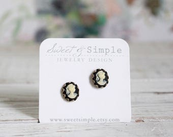 Black and cream cameo post earrings.  Lady cameos. Vintage style brass dainty studs.