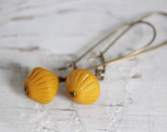 Matte mustard yellow bicone glass dangle earrings.  Antique brass Czech glass.
