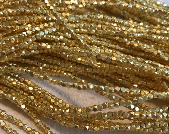 Faceted gold-plated copper nugget beads, rustic,  2-2.5mm