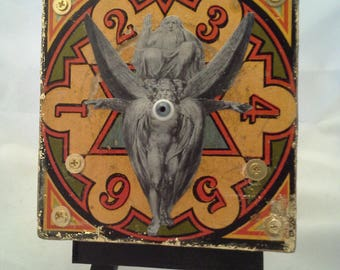 Ezekiel's Wheel: original mixed media collage, assemblage art, wall art in red and gold by Leslee Lukosh of Foundturtle in Portland