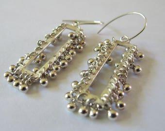Handmade sterling silver kinetic earrings