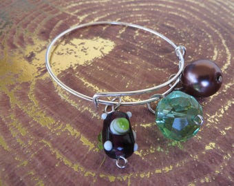 Adjustable Beaded Bangle Bracelet With Green And Eggplant Tones