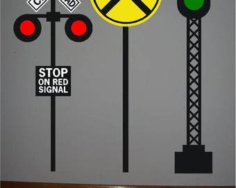 ON SALE 3 Railroad crossing signal vinyl signs...one yellow circle crossing sign, one RR stop crossing sign, one Red and green crossing sign