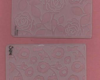2 pink embossing folders and Daisy