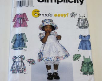 Simplicity 9142: Toddlers' Dress, Pinafore, Panties and Hat Sizes 1/2,1,2,3,4