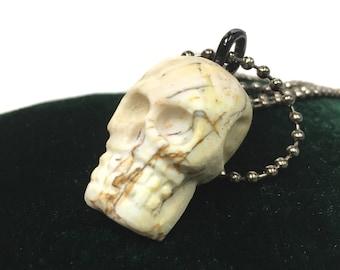 Hand Carved Petrified Wood Skull Pendant