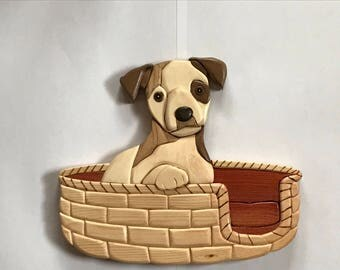 Adorable Puppy in a bsket