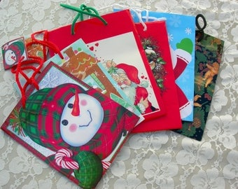 Christmas Gift Bags, 2 small and 4 medium sized, unused - like new, snowman, Santa, Santa & Mrs. Clause, gingerbread man, wreath, angels