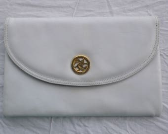 Jane Shilton white leather clutch with gold metal detail.