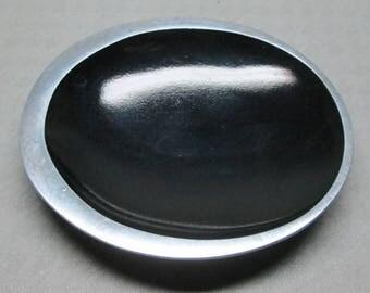 Reynolds aluminum advertising ashtray , mid - century modern style