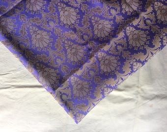 One yard of Indian brocade fabric in lavender/soft pastel purple with dull gold in a regal pattern