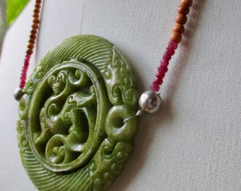 Statement carved jade necklace with large green pendant, sandalwood and rubies advanced style bold summer necklace