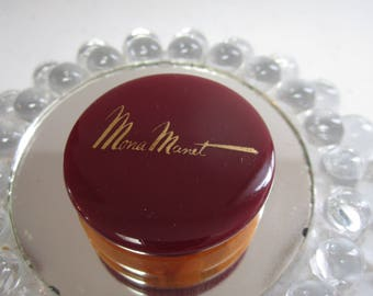 Vintage unused NOS art deco 1940's maroon and swirled butterscotch Bakelite Mona Manet Rouge container paper label and price black americana