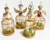 ON HOLD...........................small birdcage girl ornament, birds nest art, santos garden sprite, assemblage art by Elizabeth Rosen