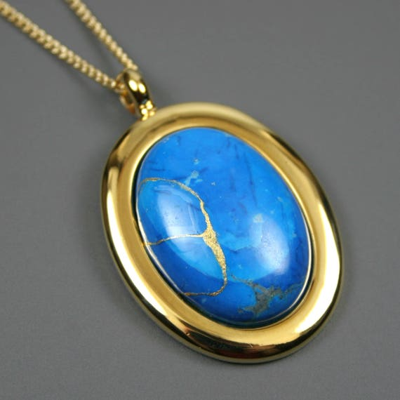 Kintsugi (kintsukuroi) turquoise howlite stone cabochon with gold repair in a gold plated setting on gold chain - OOAK