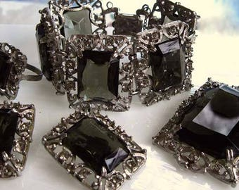 "Coventry Black Glass ""Celebrity"" Rhinestones Parure, Silvertone Brooch-Pendant, Clip Earrings, Bracelet, Cocktail Ring, c 1962"