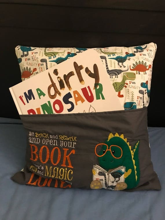 Embroidered dinosaur reading pillow with pocket x