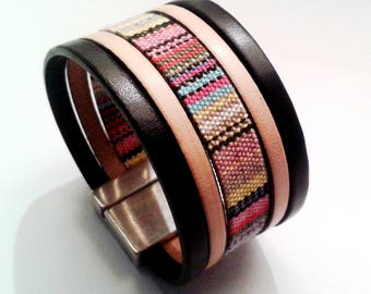 cuff black leather and ethnic matched with silver clasp