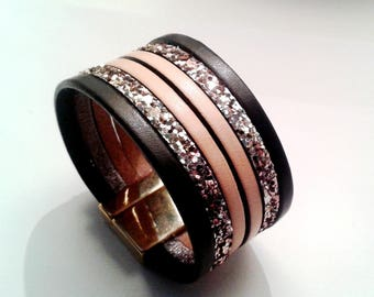 cuff black leather shell and champagne glitter egg with clasp gold