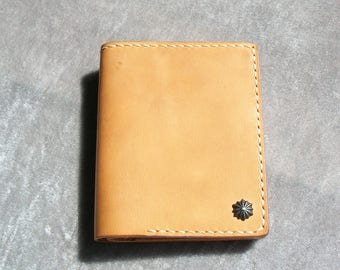 ready to ship.hand stitched short wallet ,vegetable leather.silver button