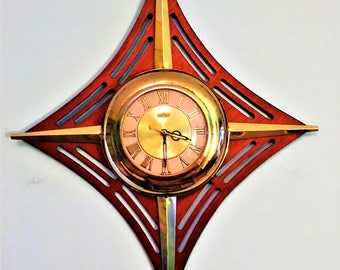 Beautiful STARBURST CLOCK by UNITED brass and wood electric works great