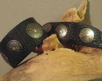 Black bull-hide leather cuff with Celtic knot/solar cross medallions