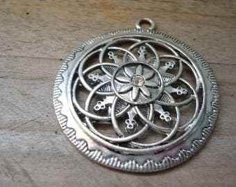 Flower pendant with central rhinestone ethnic silver metal