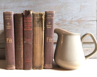 vintage book lot collection in neutral brown set of five decorative display old books