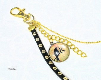 bag charm gold plated bird and suede BS156