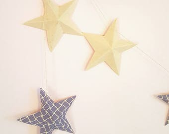 "The paper ""12 magic stars"" Garland blue and cream"