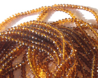 30 beads faceted glass amber color 7-8 mm (63)