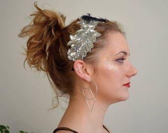 Silver sequined headband with dark blue feathers and acrylic gems