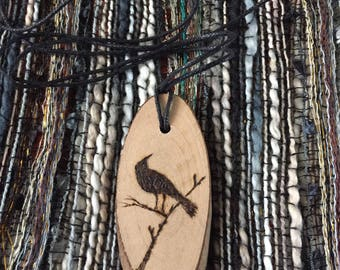 Pyrography woodburning necklace pendant bird on a branch