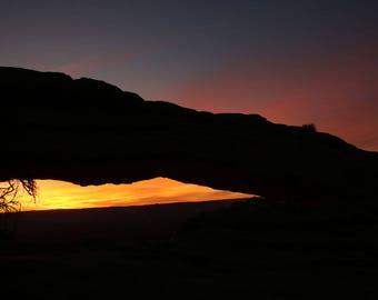 Mesa Arch early morning sunrise, Canyonlands National Park, Utah, orange, rocks, photography, scenery, landscape, clouds, Val Isenhower